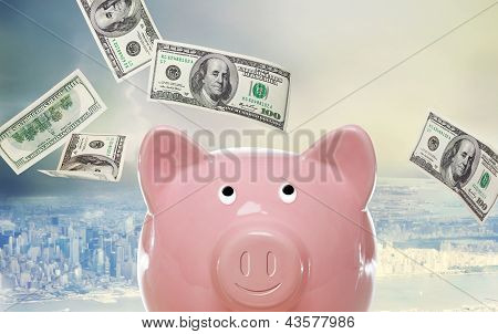 Piggy Bank With Hundred Dollar Bills