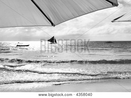 Two Umbrellas And A Sail In Black And White