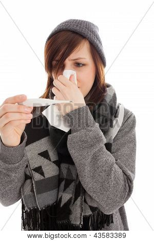 The Young Girl Is Blowing Her Nose