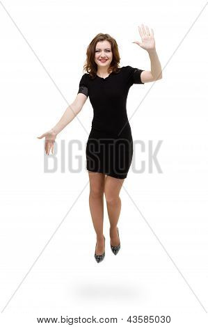 brunette girl wearing a dress jumping