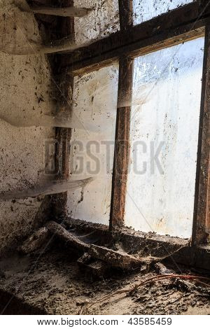 Old Window With Stains And Cobwebs
