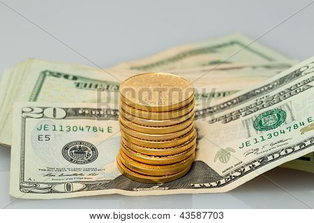 Stack Of $20 Dollar Bills With Gold Coins