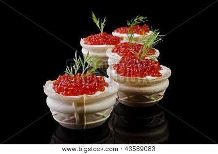 Red Caviar In Tartlet, Isolated Over Black