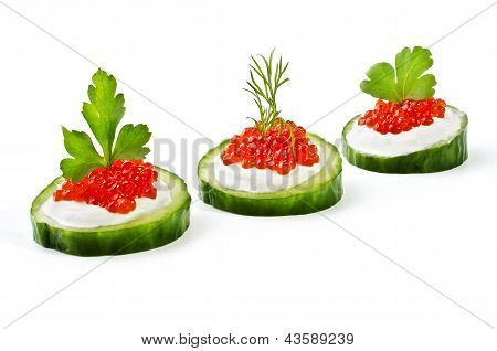 Red Caviar On A Green Cucumber, Isolated Over White