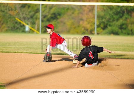 Little League Player Getting An Out