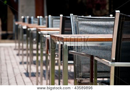 Charis And Tables On The Wooden Floor