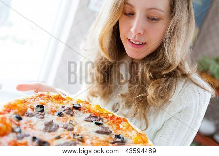 Beautiful Young Woman With Pizza