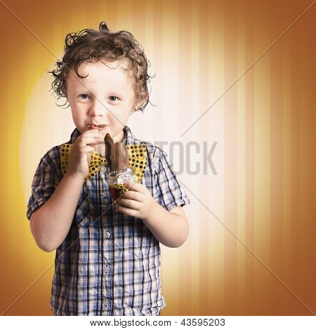 Lovable Little Child Eating Chocolate Easter Bunny