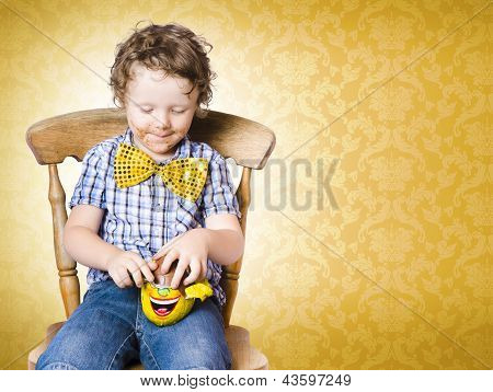 Young Boy Unwrapping Easter Egg Present