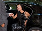 picture of politeness  - Gallant man offering his hand to a glamorous lady in the car - JPG