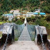 stock photo of sherpa  - hanging footbridge ower the marsyangdi nadi river annapurna himal  nepal - JPG