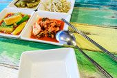 pic of kimchi  - Korean cuisine Kimchi on white square dish with spoon and Chopsticks - JPG