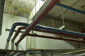 picture of hot water  - water pipes hanging from ceiling - JPG
