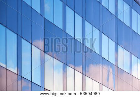 Nice Clouds Reflections In Windows Of Modern Office Building