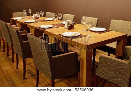 Served table with armchairs around in cafe