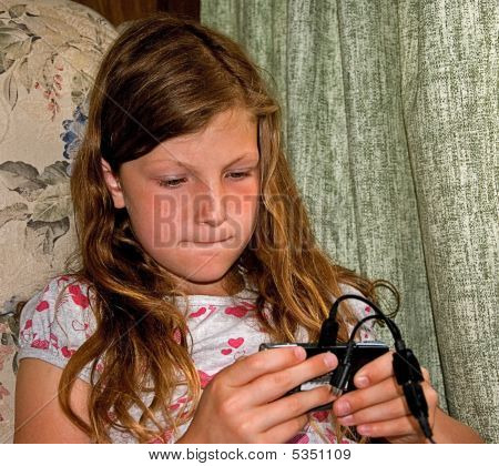 Girl Playing Electronic Game