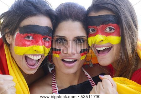 Group of happy german soccer fans commemorating victory yelling.