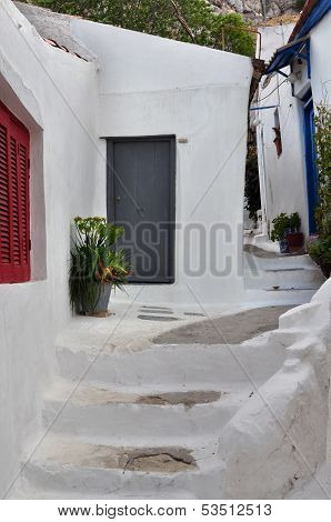 Steps And White Painted Narrow Street