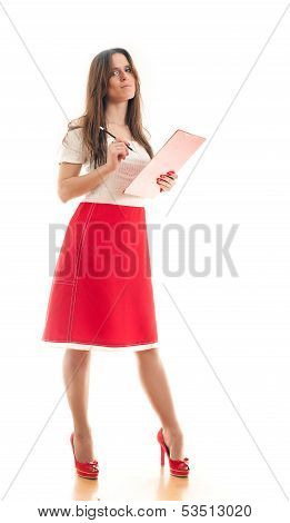 Woman Making Notes In Her Binder