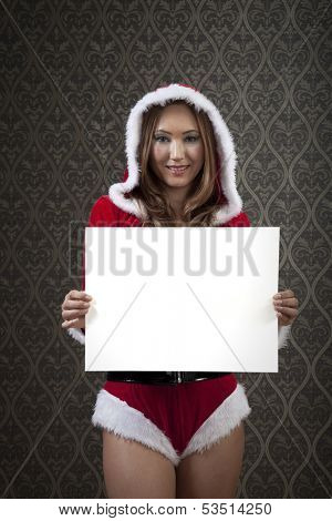 Mrs. Clause is showing us an blank white paper. Designers can easily put their own message.