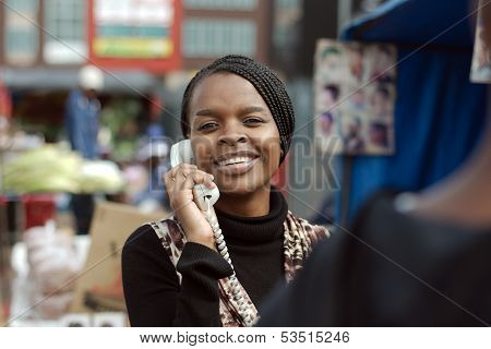 African Or Black American Woman Calling On Landline Telephone In Alexandra Township
