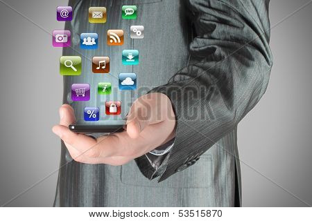 Man uses smart phone with icons
