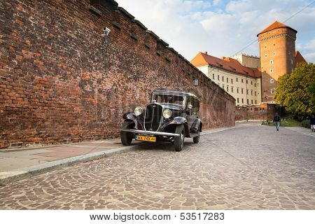 KRAKOW, POLAND - SEP 21: On territory of Royal palace in Wawel, Sep 21, 2013 in Krakow, Poland. The monument to the history of the Decree of the President Lech Walesa on September 8, 1994.
