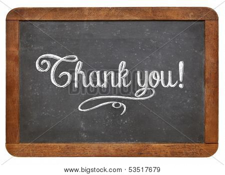 Thank you - white chalk text  on a vintage slate blackboard isolated on white