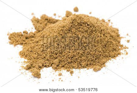 Heap of ground cumin isolated on white background