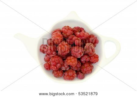 Raspberry On A Teapot Shaped Plate Isolated On White
