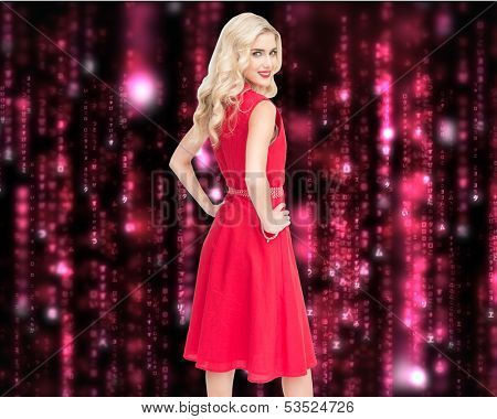 Composite image of smiling attractive blonde standing hands on hips