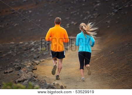 Fitness sport couple jogging outside, training together outdoors. Running on amazing nature trail