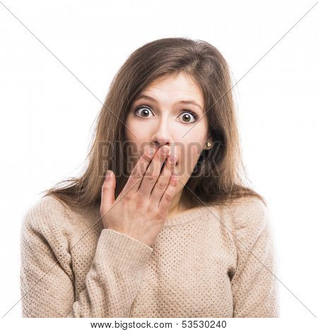 Beautiful young woman with a hand over the mouth astonished with something, isolated over white background