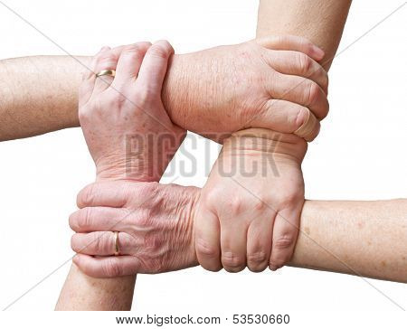 Hands of older people gripping the hands of other older people forming a rectangle in a sign of union, unity or helping each other