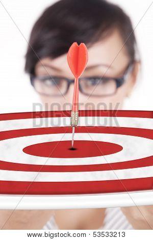 Businesswoman Showing A Dartboard