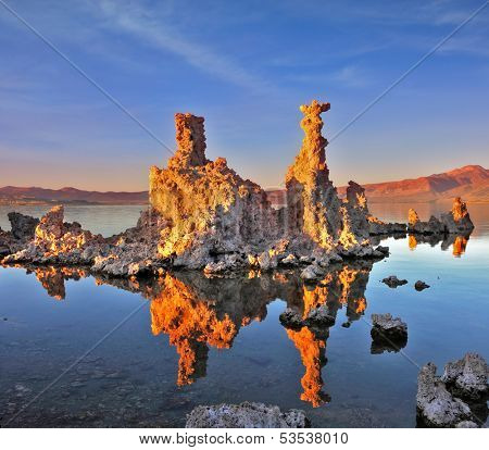 Mono Lake - a natural wonder in the United States. Outliers - bizarre limestone calcareous tufa formation  reflected in the smooth water.