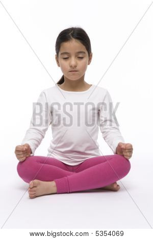 Little Girl Performing Yoga By Sitting In Lotus Position