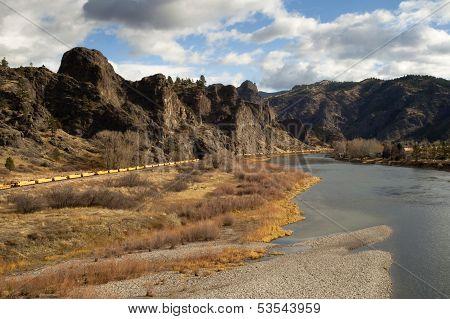 River Bend Ranch Homestead Railroad Track Boxcars Rocky Mountain Landscape