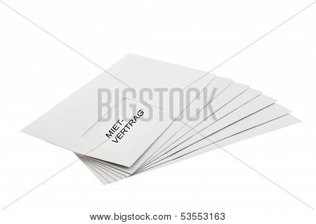 Mietvertrag On Batch Of Envelopes Isolated On White