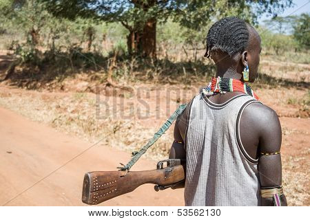 Man With Rifle Of The Hamer-banna Ethnic Group, Ethiopia. Africa