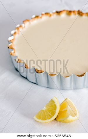 Lemon Pastry Tart On Tablecloth With Lemons