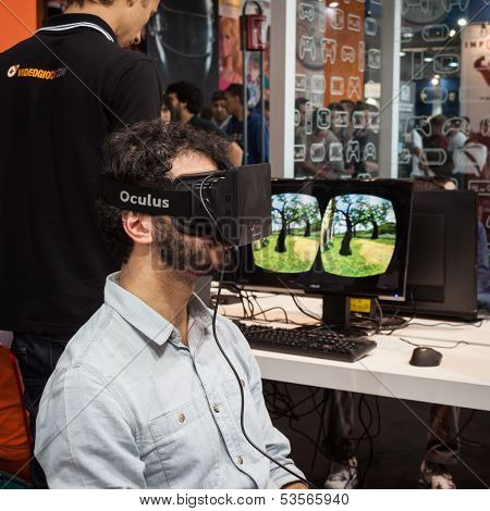 Guy With Virtual Reality Headset At Games Week 2013 In Milan, Italy