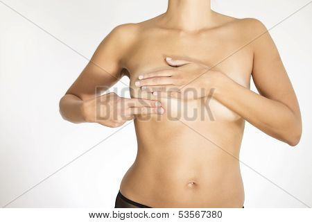 Woman Testing Her Breast For Cancer
