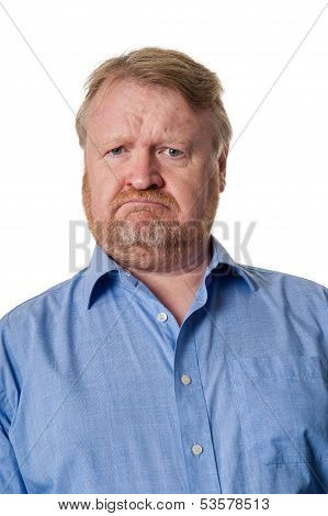 Puzzled Middle Aged Bearded Guy In Blue Shirt - On White