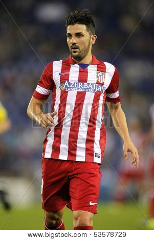 BARCELONA - OCT, 19: David Villa of Atletico de Madrid in action during a Spanish League match against RCD Espanyol at the Estadi Cornella on October 19, 2013 in Barcelona, Spain