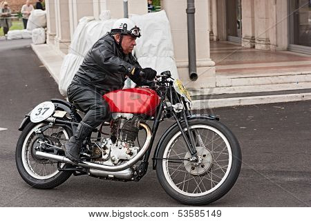 Biker Riding A Vintage Motorcycle Gileta