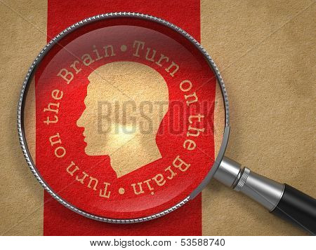 Magnifying Glass with Turn On the Brain Icon.