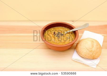 Vegetable Soup Served With Seasoning And Bread Roll