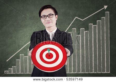 Businessman Showing Bull's eye