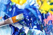 stock photo of expressionism  - Closeup of the brush and palette  - JPG